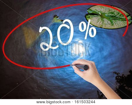 Woman Hand Writing 20% With Marker Over Transparent Board