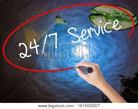 Woman Hand Writing 24/7 Service With Marker Over Transparent Board