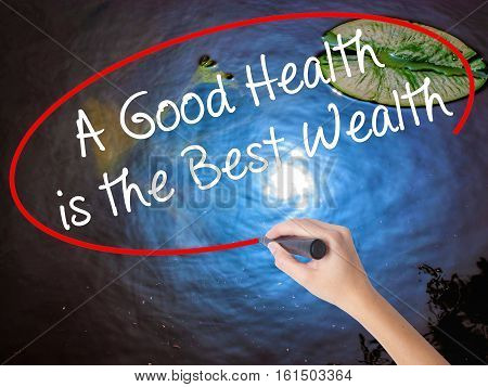 Woman Hand Writing A Good Health Is The Best Wealth With Marker Over Transparent Board