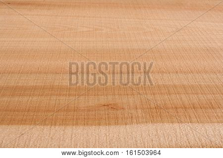 Top view on wooden longitudinal texture larch slab. Perspective view. Selective focus.