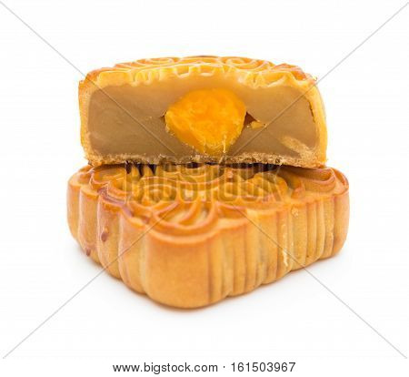 two chinese mooncake with one cut out to celebrate the Middle Autumn Day no trademark or logo