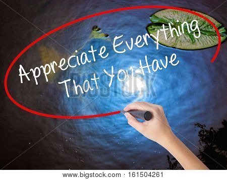 Woman Hand Writing Appreciate Everything That You Have With Marker Over Transparent Board.