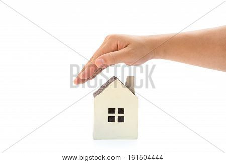 right hand covering a small family house with clipping path home insurance concept or representing home ownership