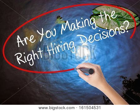 Woman Hand Writing Are You Making The Right Hiring Decisions? With Marker Over Transparent Board