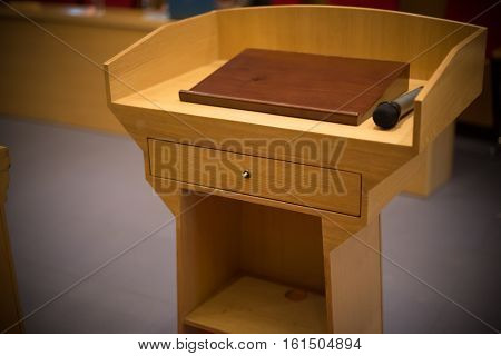 rostrum with a microphone in a reference room close up