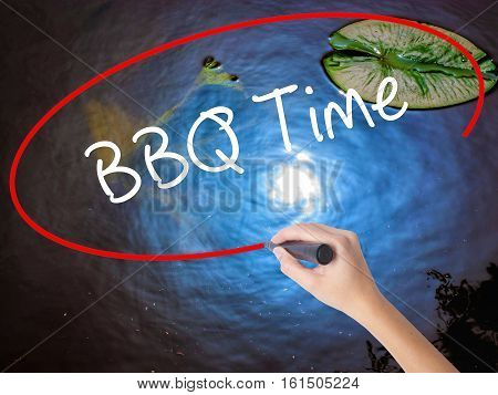 Woman Hand Writing Bbq Time With Marker Over Transparent Board