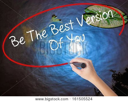 Woman Hand Writing Be The Best Version Of You With Marker Over Transparent Board