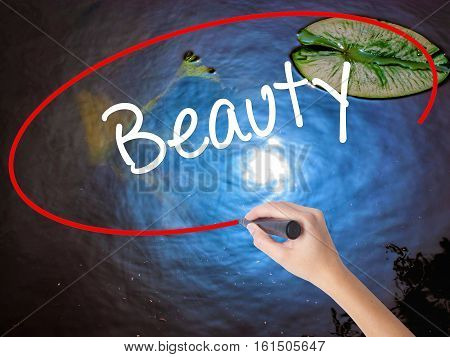 Woman Hand Writing Beauty  With Marker Over Transparent Board