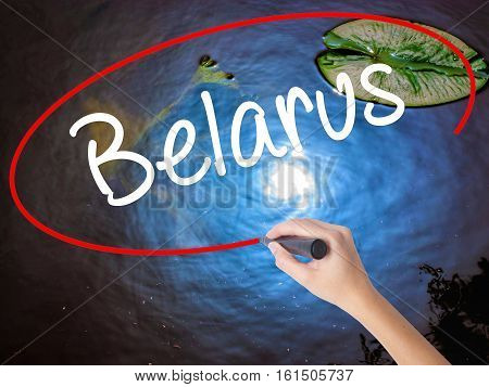Woman Hand Writing Belarus  With Marker Over Transparent Board.