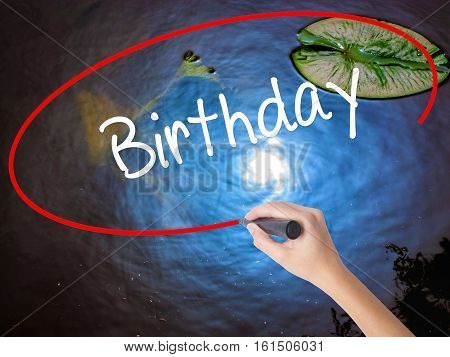 Woman Hand Writing Birthday With Marker Over Transparent Board