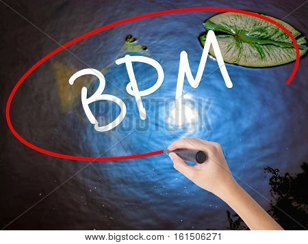 Woman Hand Writing  Bpm (business Process Management) With Marker Over Transparent Board