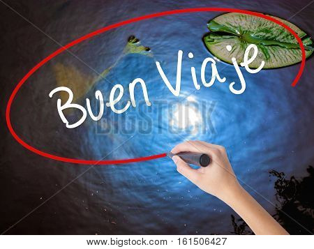 Woman Hand Writing Buen Viaje (good Trip In Spanish) With Marker Over Transparent Board