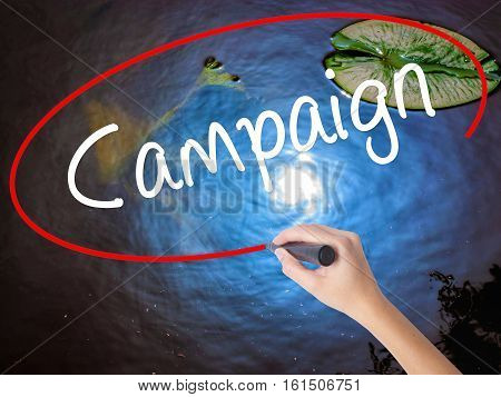 Woman Hand Writing Campaign With Marker Over Transparent Board