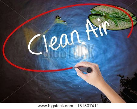 Woman Hand Writing Clean Air With Marker Over Transparent Board