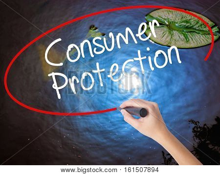 Woman Hand Writing Consumer Protection With Marker Over Transparent Board.
