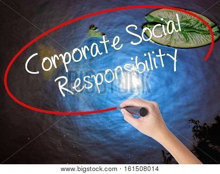 Woman Hand Writing Corporate Social Responsibility With Marker Over Transparent Board.