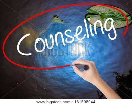 Woman Hand Writing Counseling With Marker Over Transparent Board