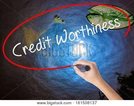Woman Hand Writing Credit Worthiness With Marker Over Transparent Board