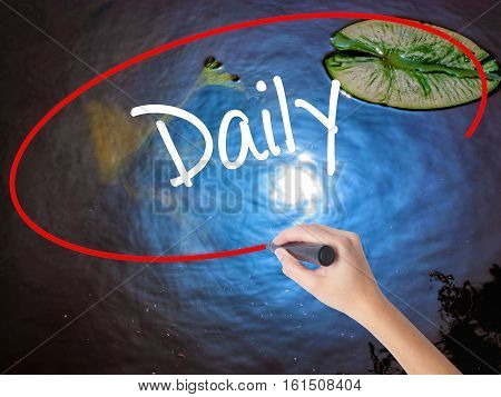 Woman Hand Writing Daily With Marker Over Transparent Board