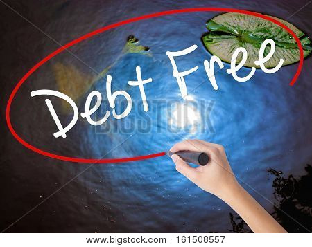 Woman Hand Writing Debt Free With Marker Over Transparent Board
