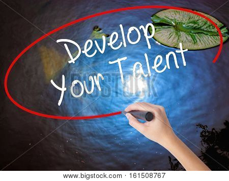 Woman Hand Writing Develop Your Talent With Marker Over Transparent Board.