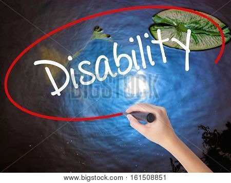 Woman Hand Writing Disability With Marker Over Transparent Board