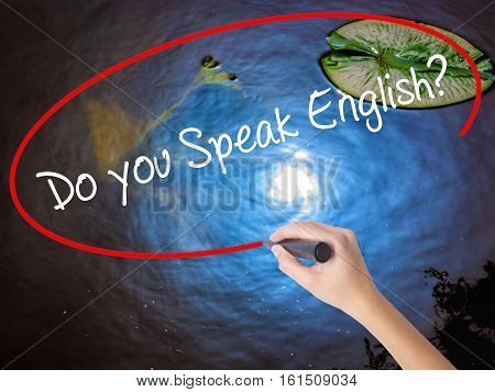 Woman Hand Writing  Do You Speak English? With Marker Over Transparent Board
