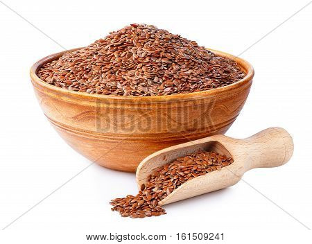 Flax seeds or linseeds in wooden scoop and in clay bowl isolated on white background