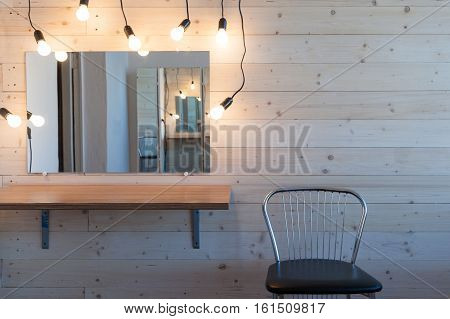 makeup table with lamp in the room