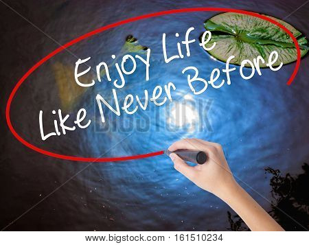 Woman Hand Writing Enjoy Life Like Never Before With Marker Over Transparent Board