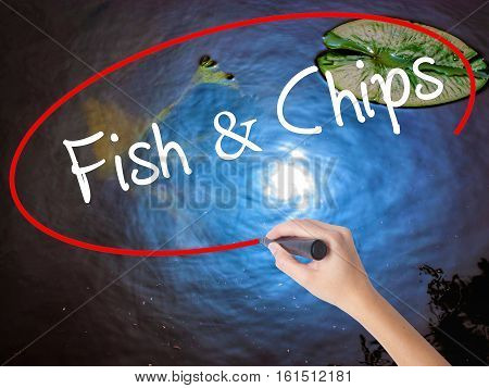 Woman Hand Writing Fish & Chips With Marker Over Transparent Board
