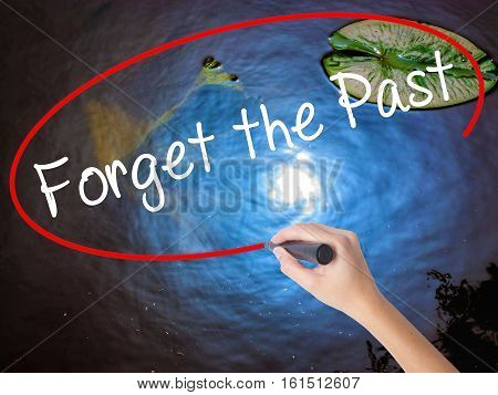Woman Hand Writing Forget The Past With Marker Over Transparent Board