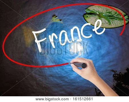 Woman Hand Writing France With Marker Over Transparent Board