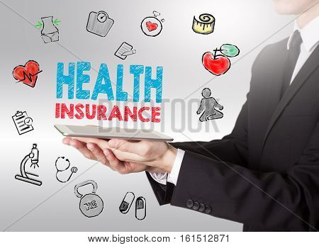 Health insurance concept. Healty lifestyle background. Man holding a tablet computer.