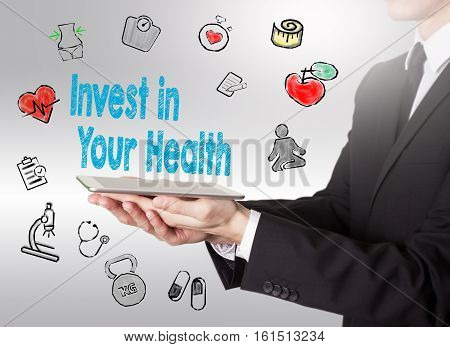 Invest in your health concept. Healty lifestyle background. Man holding a tablet computer.