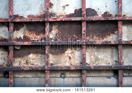 Outdoor abstract vintage steel door eroding rust.