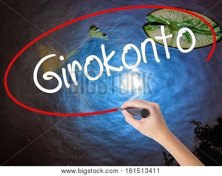 Woman Hand Writing  Girokonto (checking Account) With Marker Over Transparent Board