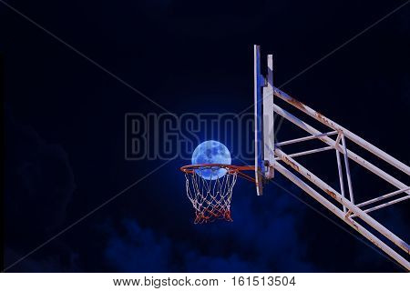 moon in a basketball hoop. success business concept