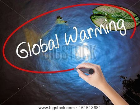 Woman Hand Writing Global Warming With Marker Over Transparent Board