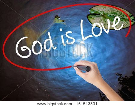 Woman Hand Writing God Is Love With Marker Over Transparent Board