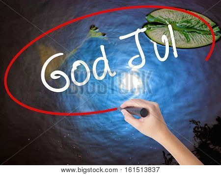 Woman Hand Writing God Jul  (merry Christmas In Swedish) With Marker Over Transparent Board