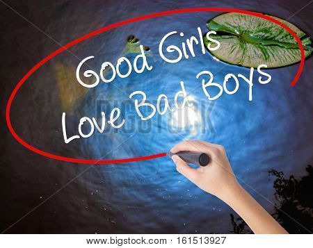 Woman Hand Writing Good Girls Love Bad Boys With Marker Over Transparent Board