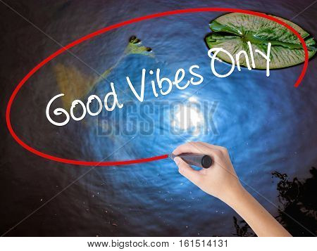 Woman Hand Writing Good Vibes Only  With Marker Over Transparent Board