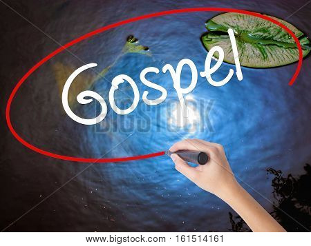 Woman Hand Writing Gospel  With Marker Over Transparent Board