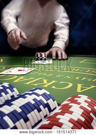 poker player at blackjack casino table it's betting