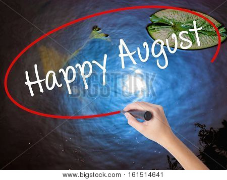 Woman Hand Writing Happy August With Marker Over Transparent Board