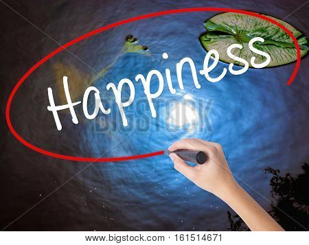 Woman Hand Writing Happiness With Marker Over Transparent Board