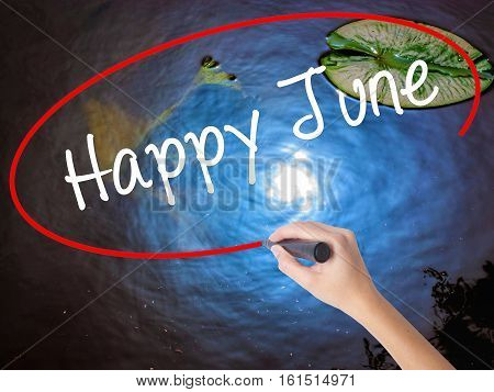 Woman Hand Writing Happy June With Marker Over Transparent Board