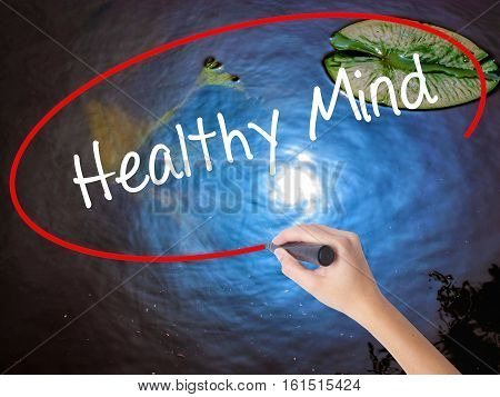 Woman Hand Writing Healthy Mind With Marker Over Transparent Board