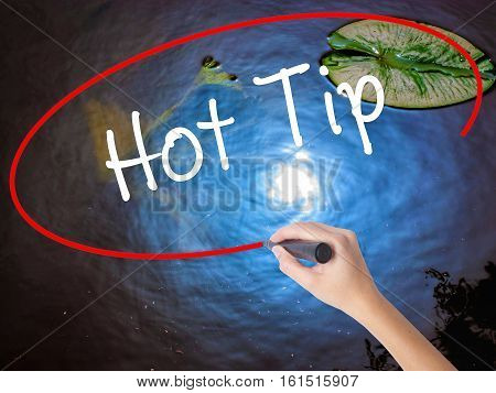 Woman Hand Writing Hot Tip With Marker Over Transparent Board.